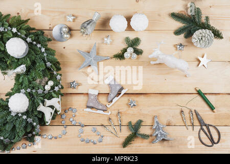 Advent wreath decoration items, self-made advent wreath with real fir tree green, DIY, glitter deer, snow ball candles, skates, birds, Christmas baubl - Stock Photo