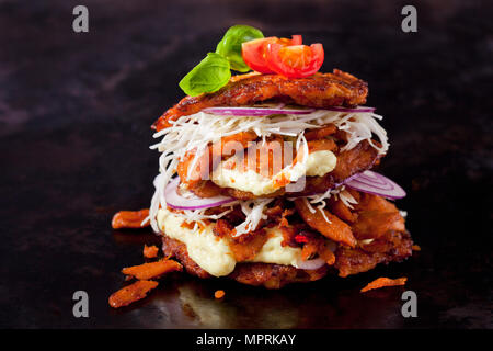 Veggie Burger made of potato fritters,  sweet potatoes, soy meat, remoulade and Barbecue sauce - Stock Photo