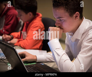 170408-N-GB257-004 CHARLESTON; S.C. (08Apr2017)  SPAWAR Systems Center Atlantic (SSC Atlantic) hosted the fifth annual Palmetto Cyber Defense Competition (PCDC) at Trident Technical College in North Charleston, SC. Students from the Home School Support Network participated in the event. The goal of PCDC is to energize South Carolina high school and collegiate students to focus on the development of networking and cyber security skills through science, technology, engineering and mathematics (STEM).  During the competitions, students from each school formed Blue Teams that operated and secured  - Stock Photo
