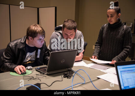170409-N-GB257-002 CHARLESTON; S.C. (09Apr2017)  SPAWAR Systems Center Atlantic (SSC Atlantic) hosted the fifth annual Palmetto Cyber Defense Competition (PCDC) at Trident Technical College in North Charleston, SC. Students from Charleston Southern University formed one of the Blue Teams that operated and secured the network of a small shipping company.  The teams were challenged to properly configure/reconfigure an IT network, add new services, and respond to additional requirements; all while defending against Red Team hackers attempting to disrupt their network.(U.S. Navy photo by Joe Bulli - Stock Photo