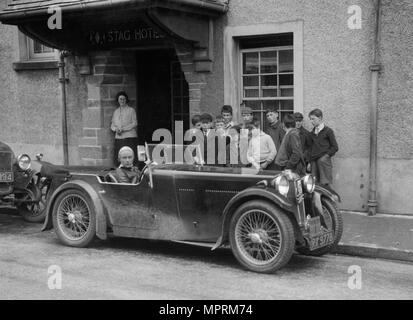 Kitty Brunell in her MG Magna outside the Stag Hotel, Edinburgh, RSAC Scottish Rally, 1932. Artist: Bill Brunell. - Stock Photo
