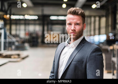Portrait of confident businessman on factory shop floor