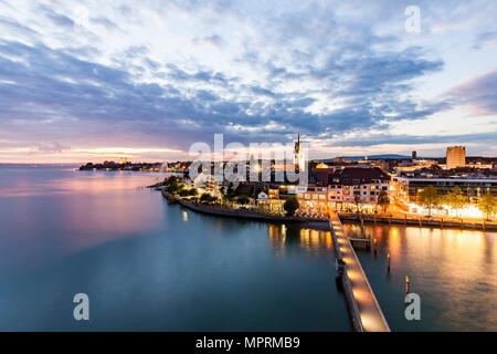 Germany, Baden-Wuerttemberg, Friedrichshafen, Lake Constance, city view and jetty in the evening - Stock Photo