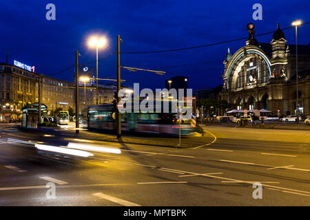 Square Central Station Frankfurt at night with blurred traffic of pedestrians, trams, busses and cars, night shot, Frankfurt, Germany, Central Railway - Stock Photo