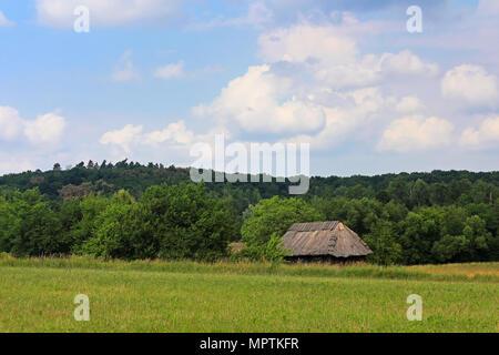 Ukrainian landscape and old traditional house, Ukraine - Stock Photo
