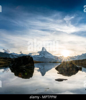 sunset at Matterhorn with reflection in Stellilake in the late afternoon - Stock Photo