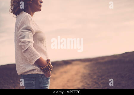 beautiful middle age caucasian woman stand up near the desert - Stock Photo