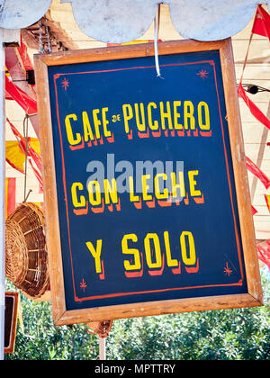 Vintage wooden signboard at a fair announcing coffee in Spanish; Pout coffee, Coffee with milk and Black coffee. - Stock Photo