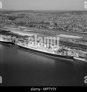 RMS 'Aquitania' at the New Docks (Western Docks), Southampton, Hampshire, 1949. Artist: Aerofilms. - Stock Photo