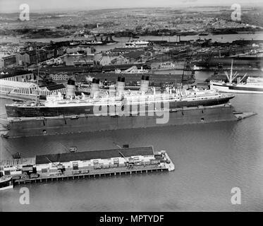 The original RMS 'Mauretania' in the floating dry dock, Southampton, Hampshire, 1933. Artist: Aerofilms. - Stock Photo