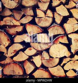 Stack of birch logs. Toned photo. Wooden bars. Wood timber construction material. Russian countryside. - Stock Photo