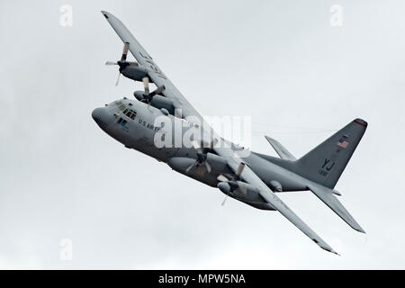 A C-130H Hercules assigned to the 36th Airlift Squadron flies over Combined Armed Training Center Camp Fuji, Japan, April 12, 2017, during a training mission. Airmen from the 374th Logistics Readiness Squadron and Eagle airlifts with the 36th AS conducted mass containerized delivery system airdrop training. (U.S. Air Force photo by Yasuo Osakabe) - Stock Photo