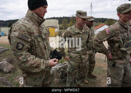 U.S. Army Command Sgt. Maj Daniel A. Dailey, 15th Sergeant Major of the U.S. Army, visited Soldiers from both the 1st Battalion, 4th Infantry Regiment and the Joint Multinational Readiness Center in Hohenfels, Germany April 20. (U.S. Army photo by Sgt. Karen Sampson) - Stock Photo