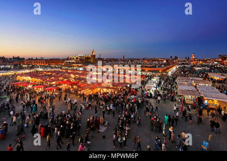 MARRAKECH, MOROCCO - 7 March 2016: Famous Jemaa el Fna square crowded at dusk. Marrakesh, Morocco - Stock Photo
