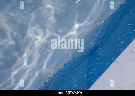 Inflatable paddling pool: beads of water on an inflatable paddling pool - Stock Photo