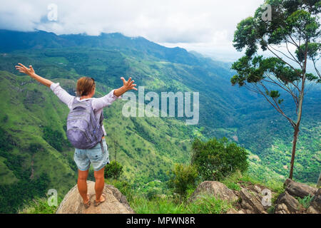 Caucasian woman standing and looking on mountain and valley. - Stock Photo