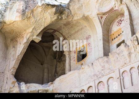 Travel to Turkey - ancient Dark Church (Karanlik Kilise) near Goreme town in Cappadocia - Stock Photo