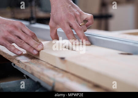 Caucasian carpenter work with wood planer - Stock Photo