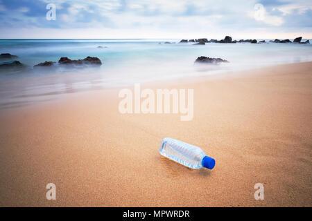 Plastic bottle on the beach. - Stock Photo