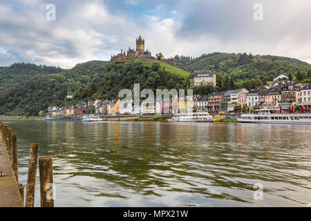 Moselle Riverbank in Cochem Germany with Imperial Castle on Hillside - Stock Photo