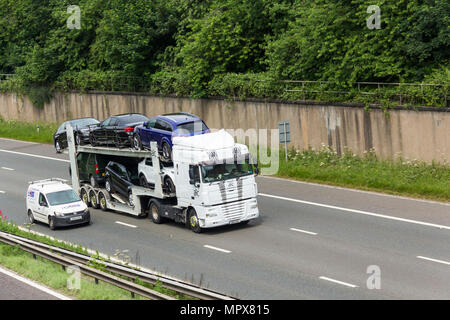 AIC Transport Ltd car transporter with Daf XF105 tractor unit travelling on the M61 motorway  near Farnworth, - Stock Photo