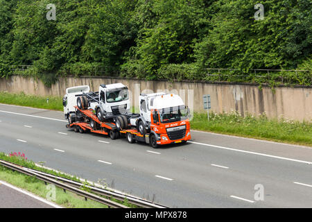 Netherlands registered, De Rooy branded, small truck transporter travelling on the M61 motorway near Farnworth, UK. - Stock Photo