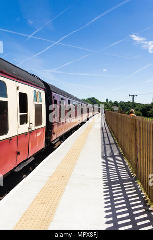 Passenger train, hauled by Class 45 'Peak' diesel 45108, at Burrs Country Park station on the East Lancashire Railway. - Stock Photo
