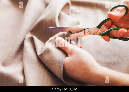 Tailoring. Man Hands notch tailor tailor's scissors cloth. Close Up. - Stock Photo