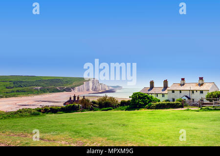 Iconic view of the coastguards cottages and the seven sisters cliffs, from Seaford head East Sussex UK - Stock Photo