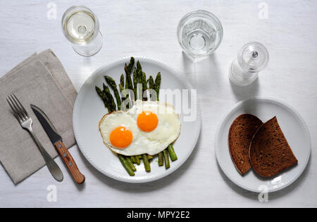 Overhead view of breakfast served with drinks on table - Stock Photo
