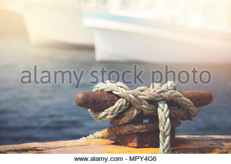 Close-up of rope tied on cleat - Stock Photo