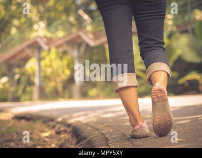 Closeup woman walking towards on the road side. Step concept. - Stock Photo