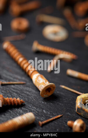 Close-up of rusty work tools on table - Stock Photo