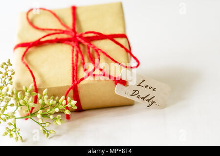 Happy father's day concept. Gift box and flower, paper tag with Love Daddy text - Stock Photo