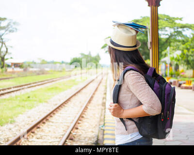 Traveler woman walking and waits train on the railway platform. Vacation and travel concept. - Stock Photo