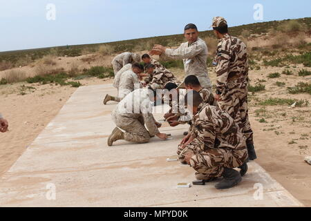 TIFNIT, Morocco - U.S. Marines instruct their counterparts from the Royal Moroccan Armed Forces on proper weapons techniques during Exercise African Lion 2017. African Lion is a combined, multilateral exercise designed to improve interoperability and mutual understanding of each nation's tactics, techniques and procedures while demonstrating the strong bond between the nation's militaries. (Photo by Thomas Flatley) - Stock Photo