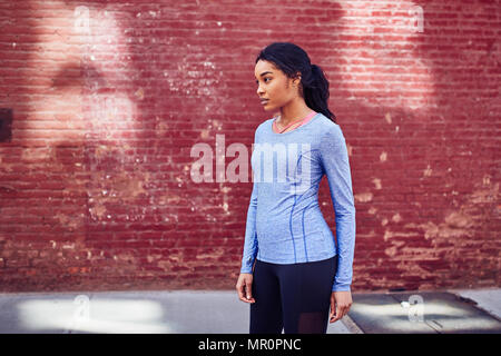 Black woman rests after running - Stock Photo