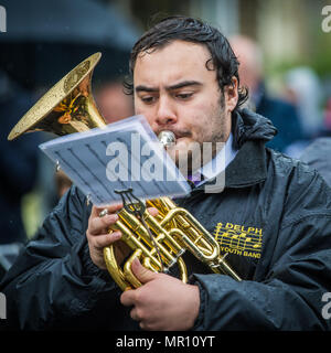 Delph, UK. 25th May 2018. A member of a brass band plays as they walk along the procession during the annual 'Whit Walks' through the village of Delph in the district of Saddleworth, Greater Manchester. Credit: Matthew Wilkinson/Alamy Live News - Stock Photo