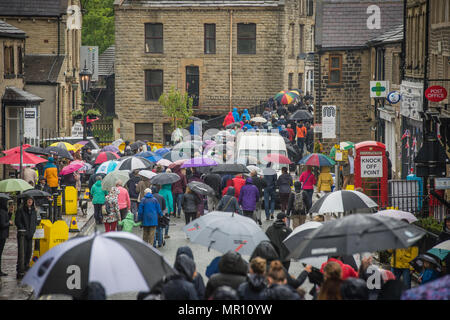 Delph, UK. 25th May 2018. A procession along the High Street during the annual 'Whit Walks' through the village of Delph in the district of Saddleworth, Greater Manchester. Credit: Matthew Wilkinson/Alamy Live News - Stock Photo