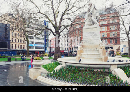 London, UK - April 2018: Statue of William Shakespeare sculpted by Giovanni Fontana, in Leicester Square Gardens in City of Westminster, London - Stock Photo