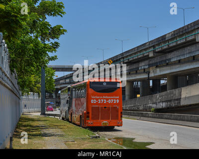 Bangkok, Thailand - Apr 22, 2017. Buses on street in Bangkok, Thailand. Bangkok is the capital of Thailand with a population of over 7 million inhabit - Stock Photo