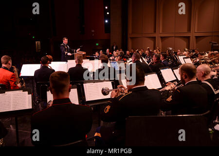 170429-N-VH385-087 BREMERTON, Wash. (April 29, 2017) Chief Warrant Officer Russell Houser, from Mifflinville, Pennsylvania, conducts members of Navy Band Northwest, U.S. Air Force Band of the Golden West, the I Corps Army Band, U.S. Marine Corps Forces Pacific Band and the Canadian Band of the Fifteenth Field Artillery Regiment during the annual International Military Band Concert (IMBC) at Bremerton High School. This year marks the 26th annual IMBC, which allows international bands to assemble and perform together for audiences throughout the Pacific Northwest.  (U.S. Navy photo by Mass Commu - Stock Photo