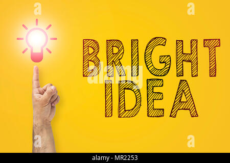 Bright idea in hand. Finger pointing on a light bulb. Concept of new idea - Stock Photo