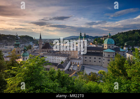 Salzburg, Austria. Cityscape image of the Salzburg, Austria with Salzburg Cathedral during spring sunset. - Stock Photo