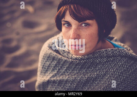 nice young lady portrait in vintage style filter. look at the camera with freckles on the face - Stock Photo