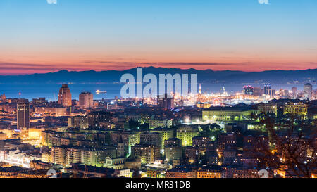Panoramic view of Genoa during the twilight - Stock Photo