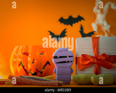 isolated on white background happy halloween decorations and candies on orange background stock photo