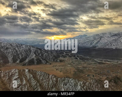 First rays of sun on the city of Leh. Sunrise is one of the finest natural moment in which everyone forgets the stress and bad days of routine. - Stock Photo