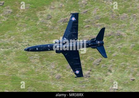 Hawk T2 flying through the Mack Loop - Stock Photo