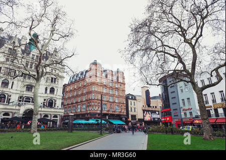 London, UK - April 2018: Old buildings with shops, restaurants, and entertainment venues around Leicester Square, Central London - Stock Photo